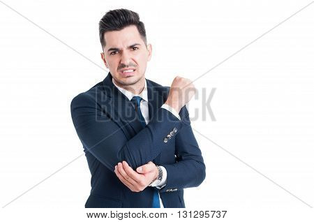 Injured Businessman Suffering Of Elbow Pain