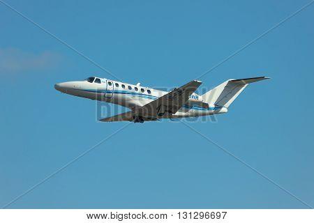 Kiev Ukraine - March 24 2011: Cessna 525B Citation Jet CJ3 is taking off from against blue sky