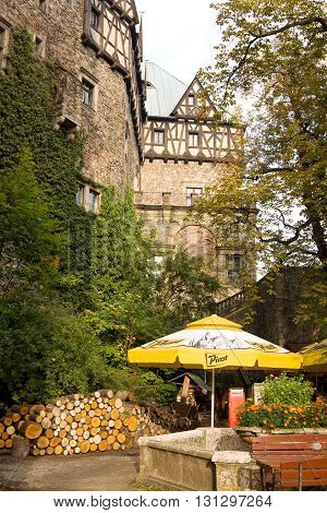 WALBRZYCH, POLAND - SEPTEMBER 18, 2010: A cosy nook near the walls of the Ksiaz castle in Poland. The Ksiaz castle was built in 1288-1292. It is today one of the city's main tourist sights.