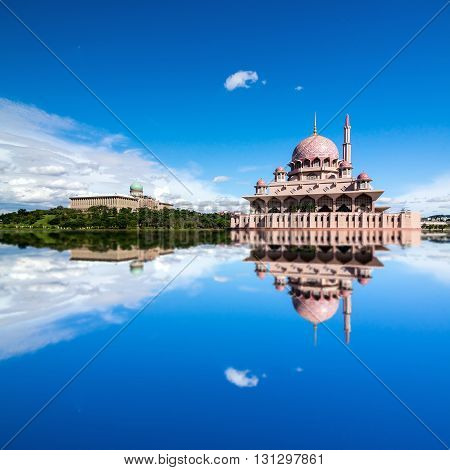 Beautiful View Of Putra Mosque In Putrajaya, Malaysia During A Bright Sunny Day With Full Reflection