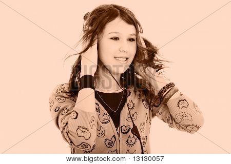 Portrait of a styled professional model. Theme: teens, beauty, music