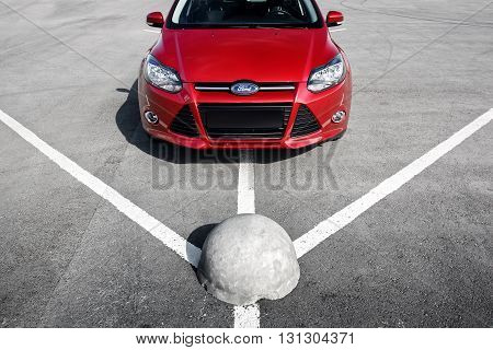 Engels, Russia - September 21, 2014: Red car Ford Focus III Sport on asphalt parking at daytime