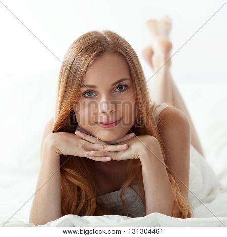 Horizontal view of woman's morning in bed