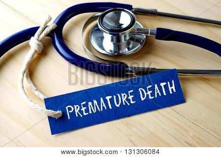 Medical Conceptual Image With Premature Death Word Written On Label Tag And Stethoscope On Wooden Ba