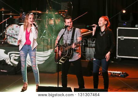 PATCHOGUE, NY-MAR 9: (L-R) Singers Maddie Salute, Dawson Anderson, and Emma Salute of Temecula Road perform onstage at the Emporium on March 9, 2016 in Patchogue, New York.