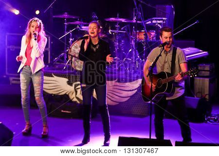 PATCHOGUE, NY-MAR 9: (L-R) Singers Maddie Salute, Emma Salute and Dawson Anderson of Temecula Road perform onstage at the Emporium on March 9, 2016 in Patchogue, New York.