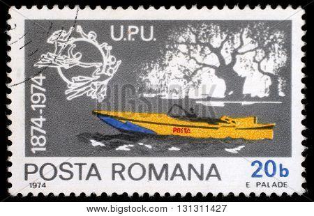 ZAGREB, CROATIA - JULY 19: a stamp printed in Romania shows Mail motorboat, Centenary of UPU, circa 1974, on July 19, 2012, Zagreb, Croatia