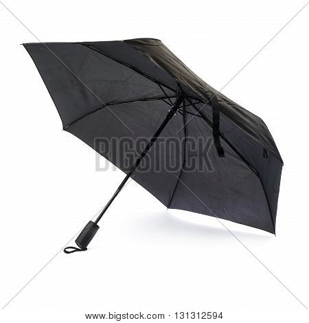 Black unfolded umbrella isolated over the white background
