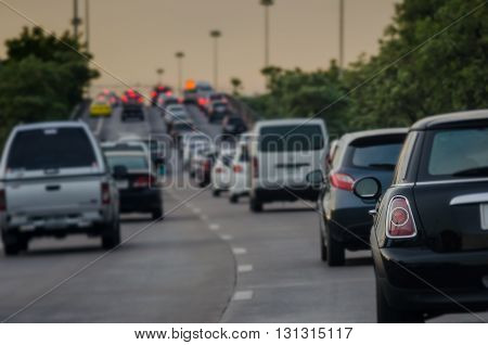traffic jam with row of cars on express way during rush hour before night