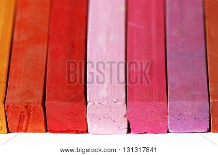Detail of the crayons - pastles - range of warm colors