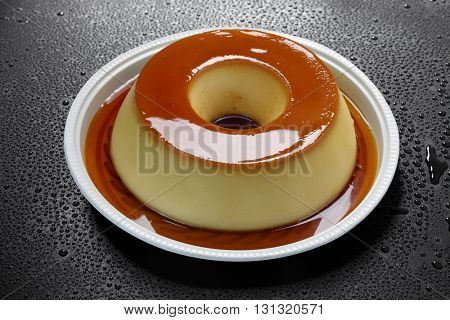 Pudding with milk and eggs with syrup