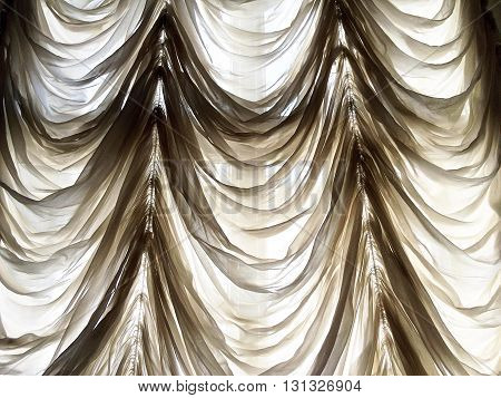 Transparent draped curtain in fron of window