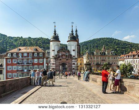 People Visit Old Bridge And Town Gate  In Heidelberg