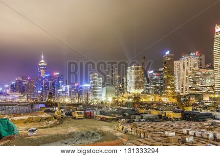 View During Hong Kong Harbor Laser Show To Skyline Of Victoria And A Construction Site