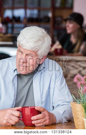 Grumpy Mature Man In Coffee House