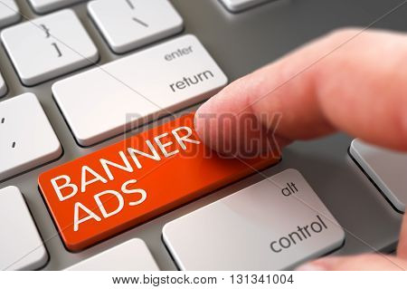 Banner Ads - Metallic Keyboard Concept. Close Up view of Male Hand Touching Banner Ads Computer Key. Computer User Presses Banner Ads Orange Button. 3D Render.