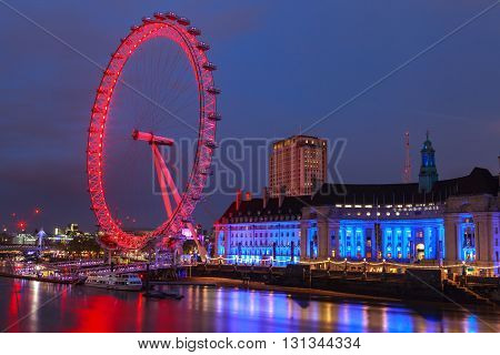 LONDON UNITED KINGDOM - 22 MAY 2016: London Eye is the tallest Ferris wheel in Europe Big Ben and Country Hall in London United Kingdom