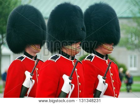 Quebec city,Canada-August 24th,2013: Picture of 3 guards at changing of the Guard ceremony in Quebec city, Quebec, Canada.