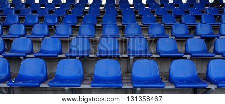 Plastic seats section on the grandstand of sport stadium