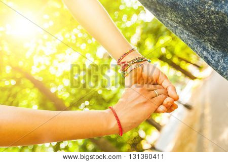 Two Girls Holding Hands At Park