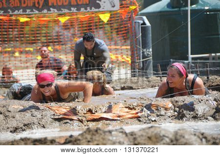 Acton, Californi-May 21 2016: People in the Hot and Dirty Mud Run