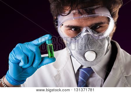 Holding A Green Vial
