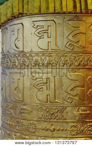 detail of giant prayer wheels in thekchen choling temple singapore