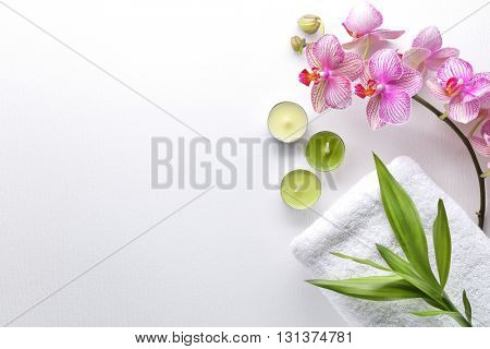 Towel,orchid flowers,bamboo leaf and candle