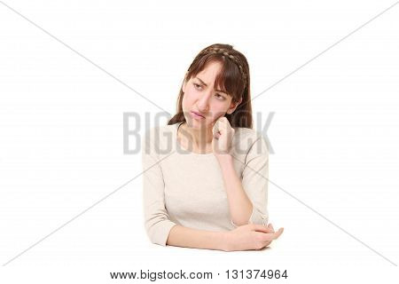young woman worries about something on white background
