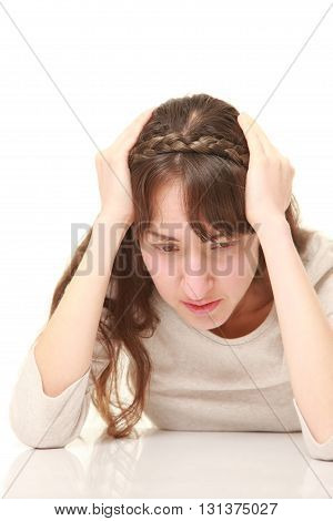 studio shot of perplexed woman on white background