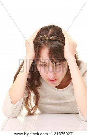 studio shot of perplexed woman on white background