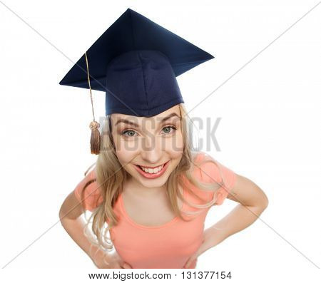 people, graduation and education concept - smiling young student woman in mortarboard