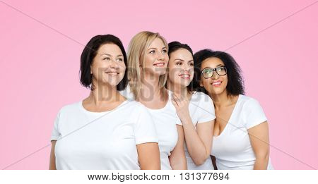 friendship, diverse, body positive and people concept - group of happy different size women in white t-shirts over pink background