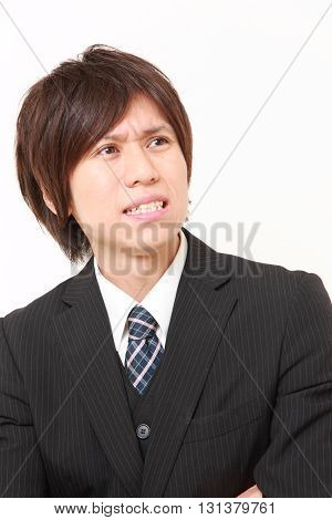 studio shot of  perplexed businessman on white background