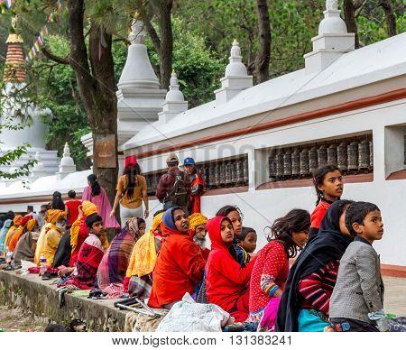 KathmanduNepal - May 21 2016 : Poor Nepali people are begging in Swayambhunath Stupa on Buddha Jayanti or Buddha's Birthday.
