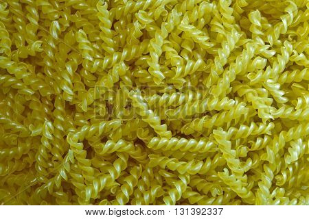 Pasta gimlet texture background. Pasta is a staple food of traditional Italian cuisine. Closeup.