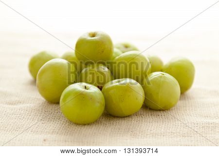 Collection of Organic Indian gooseberry or Amla (Phyllanthus emblica) on jute mat.