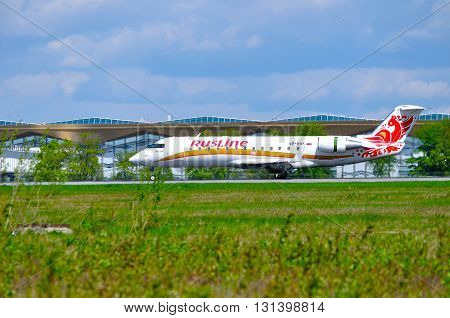 SAINT PETERSBURG RUSSIA - MAY 11 2016. Rusline Airline Canadair Regional Jet CRJ-100ER airplane -registration number VP-BVK rides on the runway after landing in Pulkovo International airport