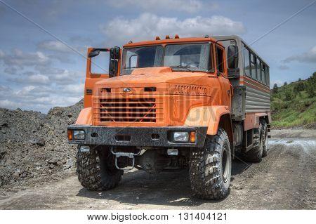 Poltava Region Ukraine - June 26 2010: Mining crew bus on the iron ore the opencast