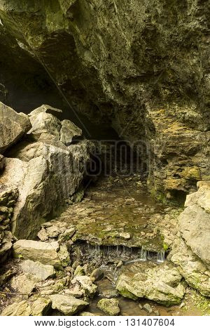 A stream flowing out of a cave.