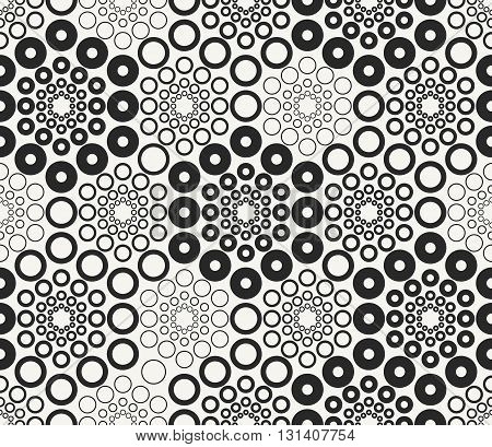Monochrome geometric vector seamless pattern. Modern stylish hexagonal decorative ornament with irregular circles. Repeating background for textiles wrapping paper or wallpaper.