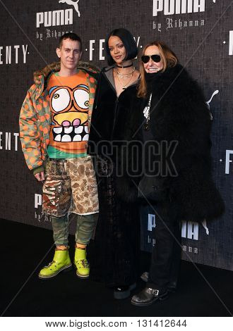 NEW YORK-FEB 12: Fashion designer Jeremy Scott (L) and Rihanna (C) attend the FENTY PUMA by Rihanna AW16 Collection during Fall 2016 New York Fashion Week on February 12, 2016 in New York City.