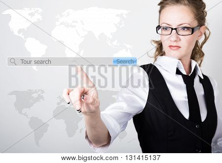 tour search written in search bar on virtual screen. Internet technologies in business and home. woman in business suit and tie, presses a finger on a virtual screen.