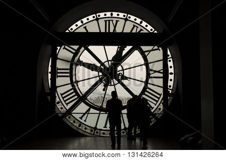 Silhouettes in front of the glass clock in Musee d Orsay Paris