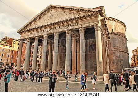 ROME ITALY - APRIL 9 2016: Tourists visit the Pantheon on APRIL 9 2016 in Rome Italy. Pantheon is a famous monument of ancient Roman culture the temple of all the gods built in the 2nd century.