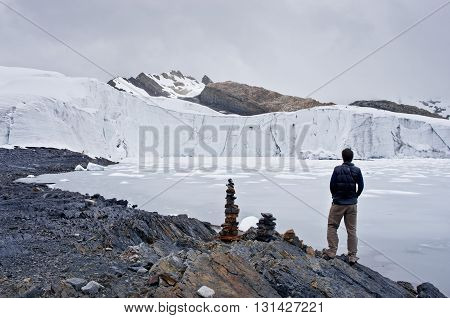 traveler near Pastoruri glacier in Cordillera Blanca Northern Peru