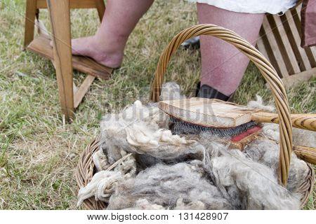 Tewkesbury, UK-July 17, 2015: Raw sheep wool in basket awaiting spinning on 17 July 2015 at Tewkesbury Medieval Festival