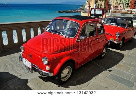 Camogli Liguria Italy - September 20 2015 Festival Fiat 500 Rally Rally takes place on the beach Camogli Garibaldi Street. Between 11 am and 12:30 the participants created a tour of the city east. Is a symbol of Italian design and legendary country. Fiat