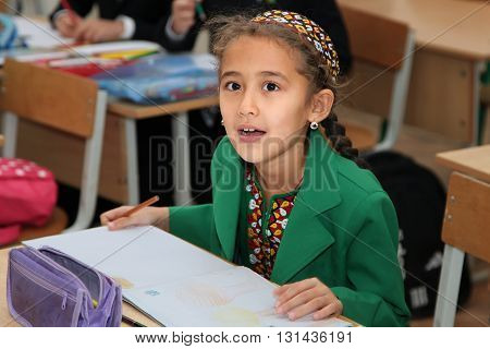 Ashgabad Turkmenistan - November 4 2014. Portrait of an unknown schoolgirl in the classroom. November 4 2014. In schools of Turkmenistan annually trains about 900 thousand children.