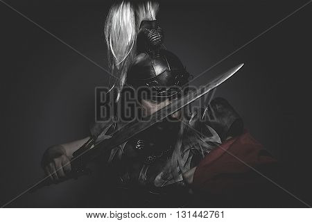 Strengh warrior helmet, armor and red cape on a battlefield, conflict and struggle in the Roman Empire poster